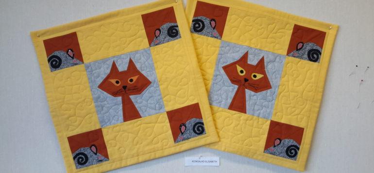 Kaksi tyynyä kissa ja hiiri aiheilla